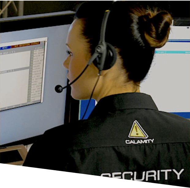 female Calamity staff looking at a computer monitor while wearing a headset